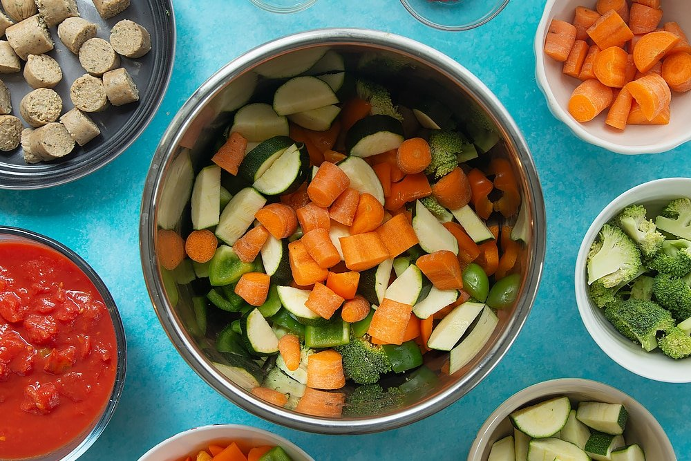Overhead shot of the bowl of ingredients for the Slow-cooked vegetarian sausage casserole.