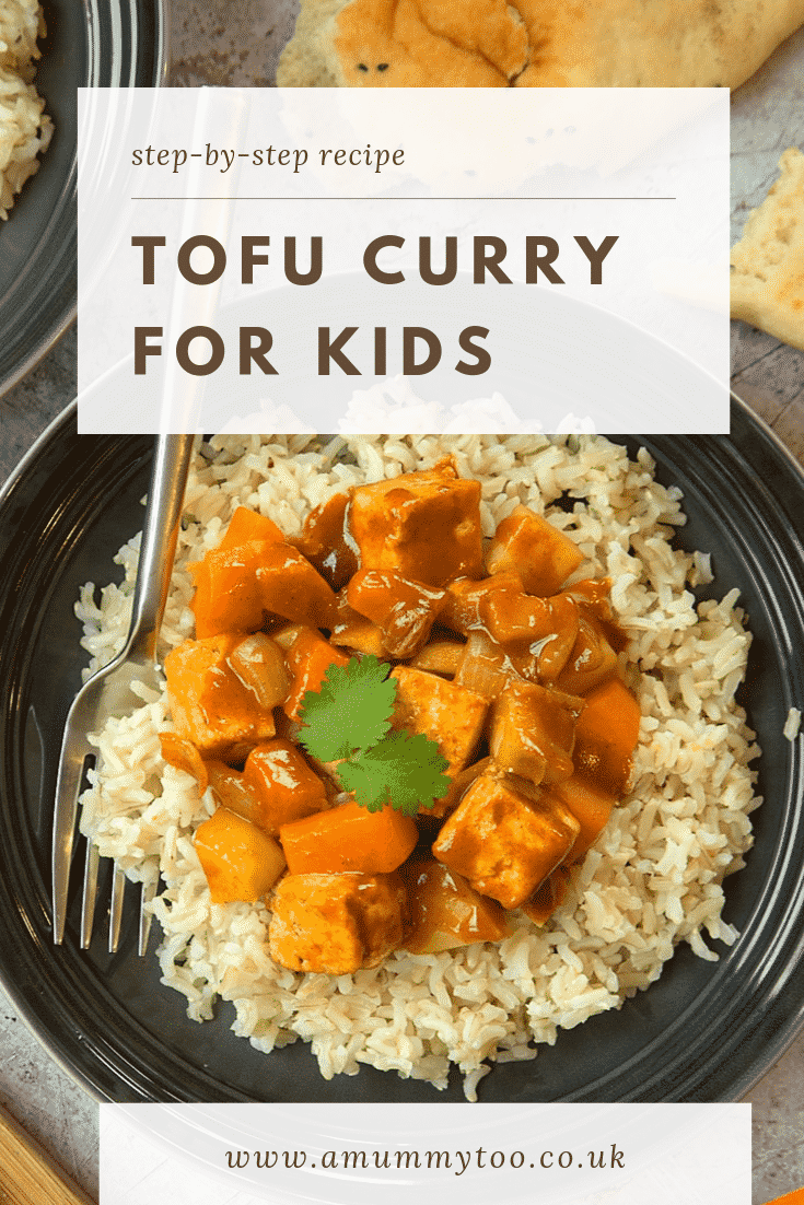 Overhead shot of the tofu curry for kids on a black plate with some bread on the side. At the top of the image there's some text describing the image for Pinterest.