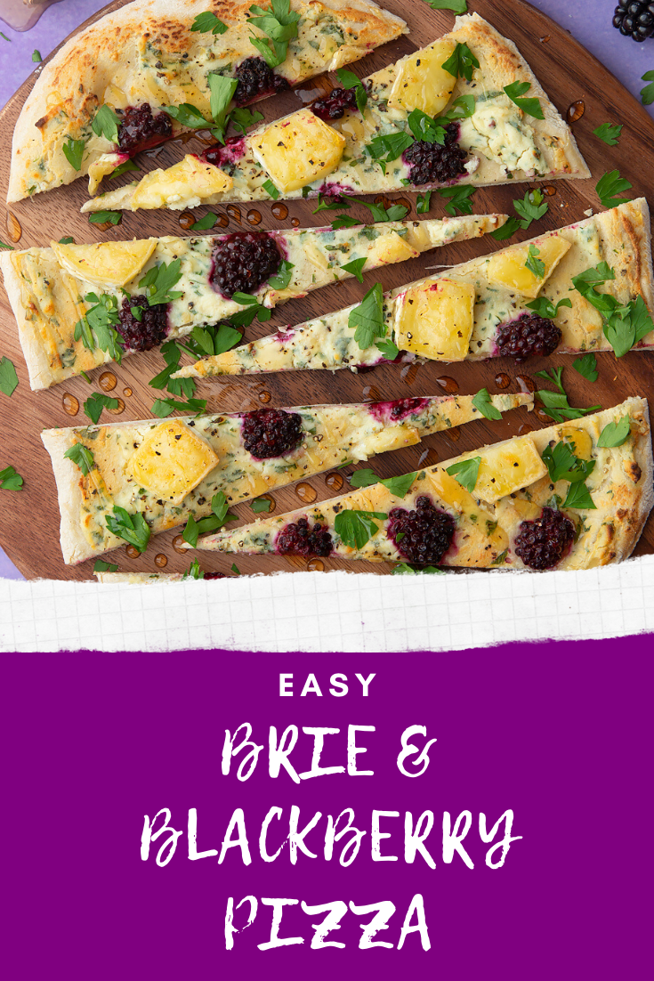 Brie and blackberry pizza sliced on a wooden board and scattered with fresh parsley. Caption reads: Easy brie & blackberry pizza.