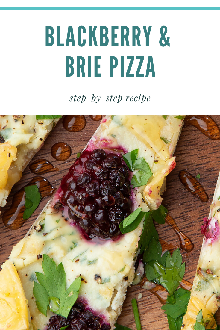 Brie and blackberry pizza sliced on a wooden board and scattered with fresh parsley and drizzled with honey. Caption reads: brie & blackberry pizza step by step recipe