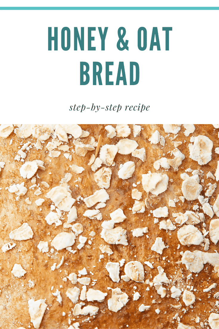 Close up of honey and oat bread. At the top of the image there's some teal text describing the image for Pinterest.