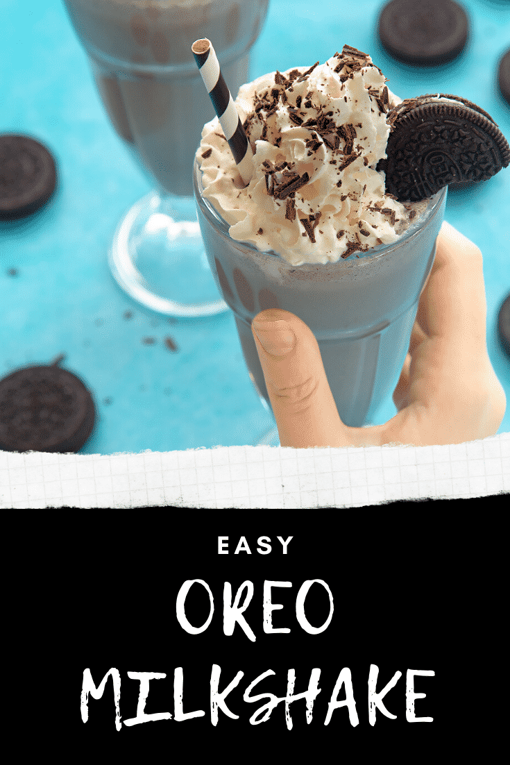 Hand holding an oreo milkshake with an additional milkshake in the background on a light blue table. At the bottom of the image there's some text describing the image for Pinterest.