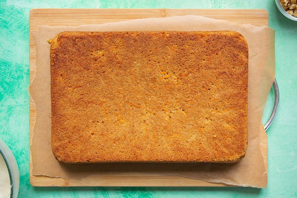 Once cooled the carrot cake tray bake is moved onto a serving board.