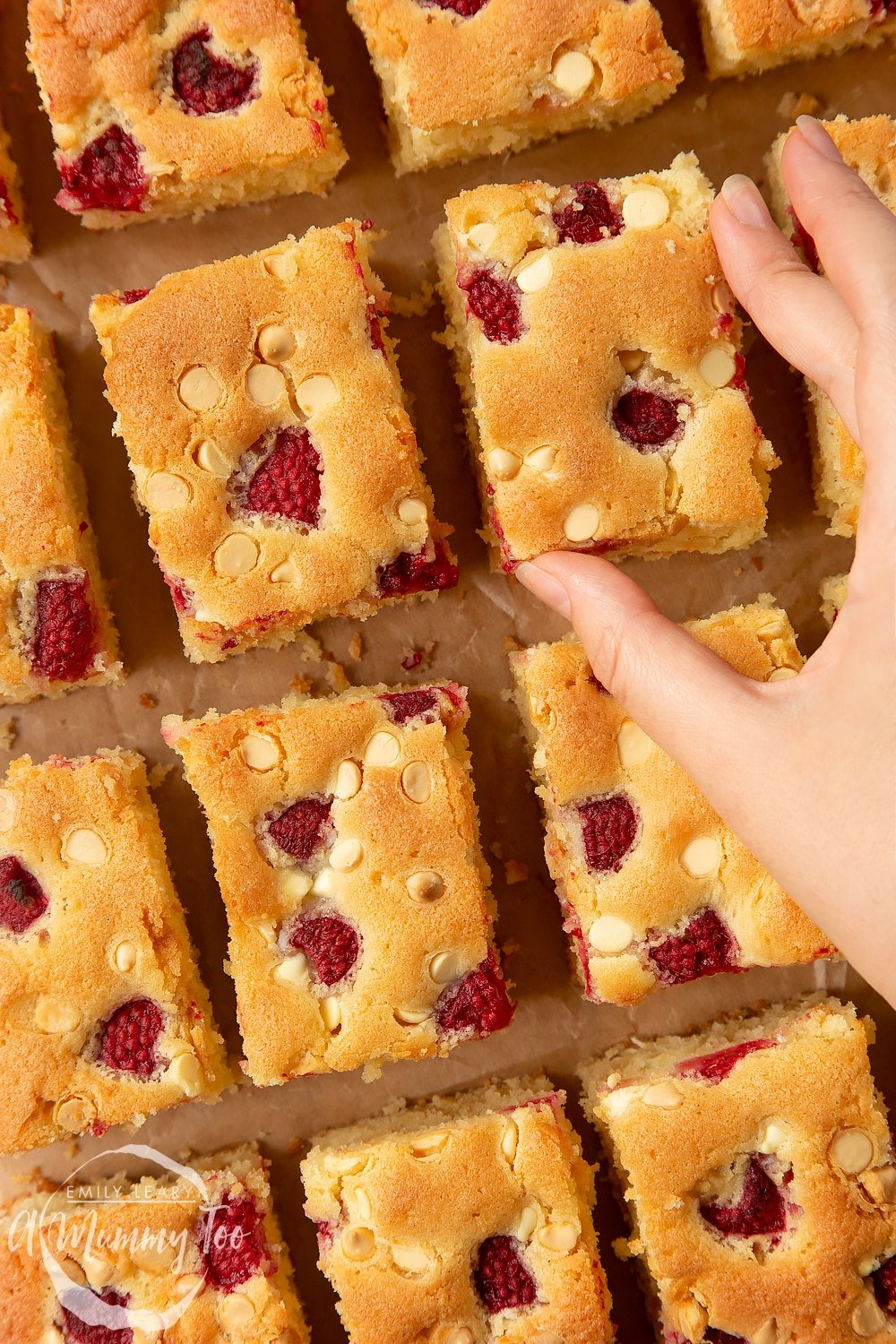 Picking up a serving of the incredible raspberry and white chocolate traybake