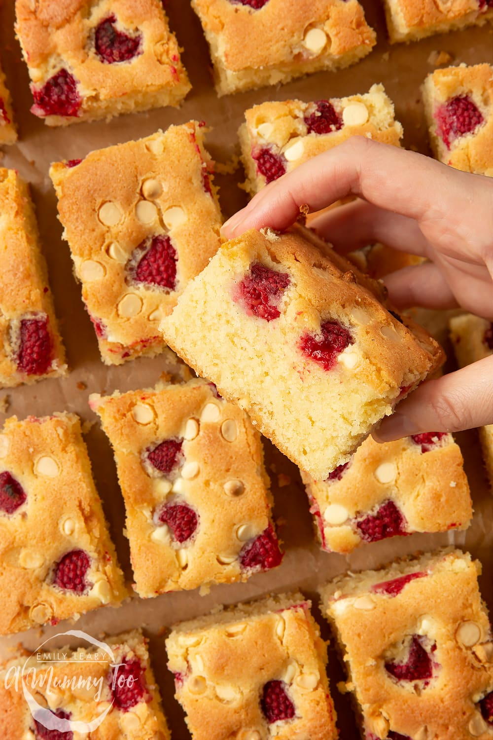 A slice of baked raspberry and white chocolate traybake