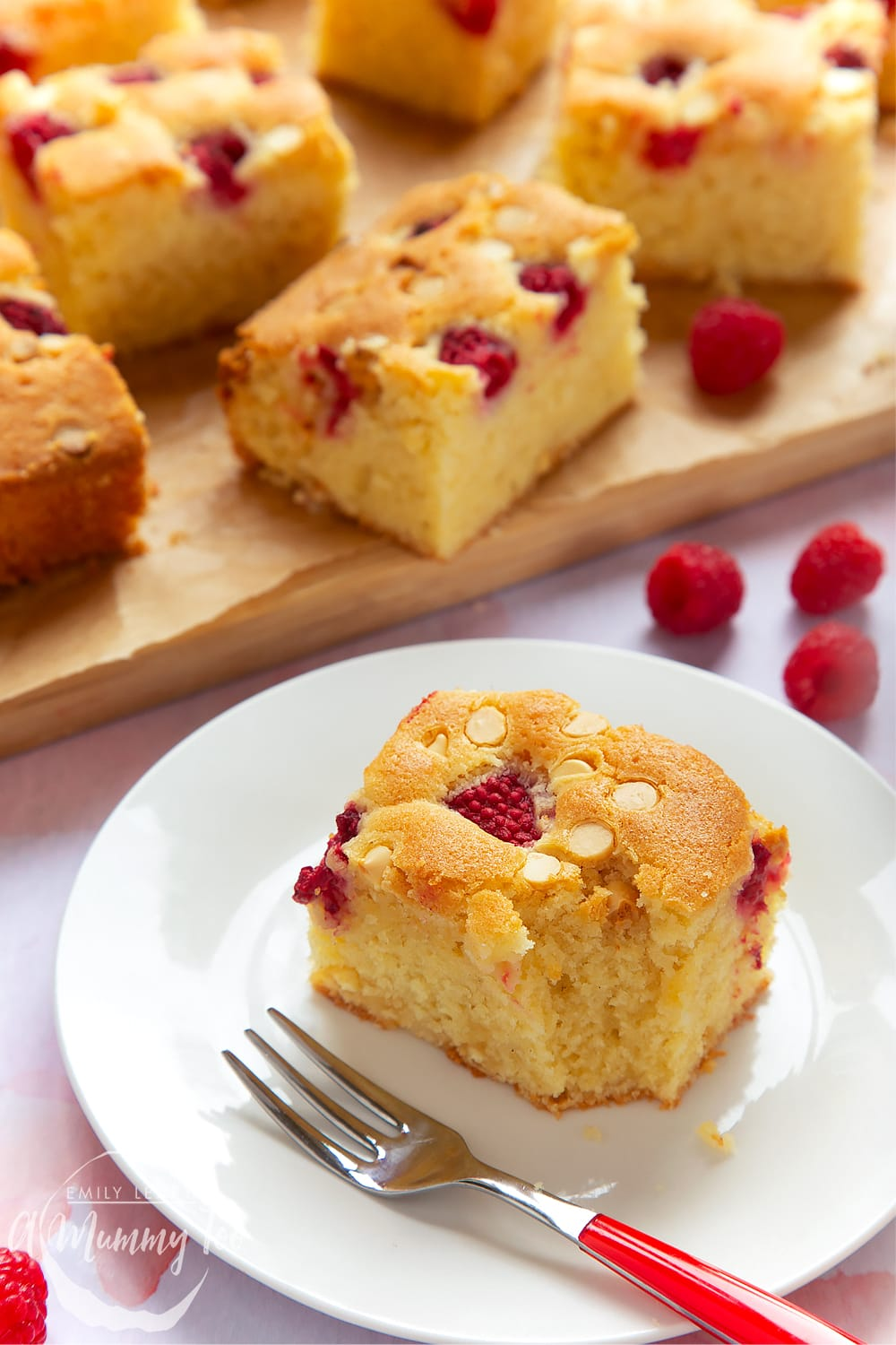 A plated serving of raspberry and white chocolate traybake