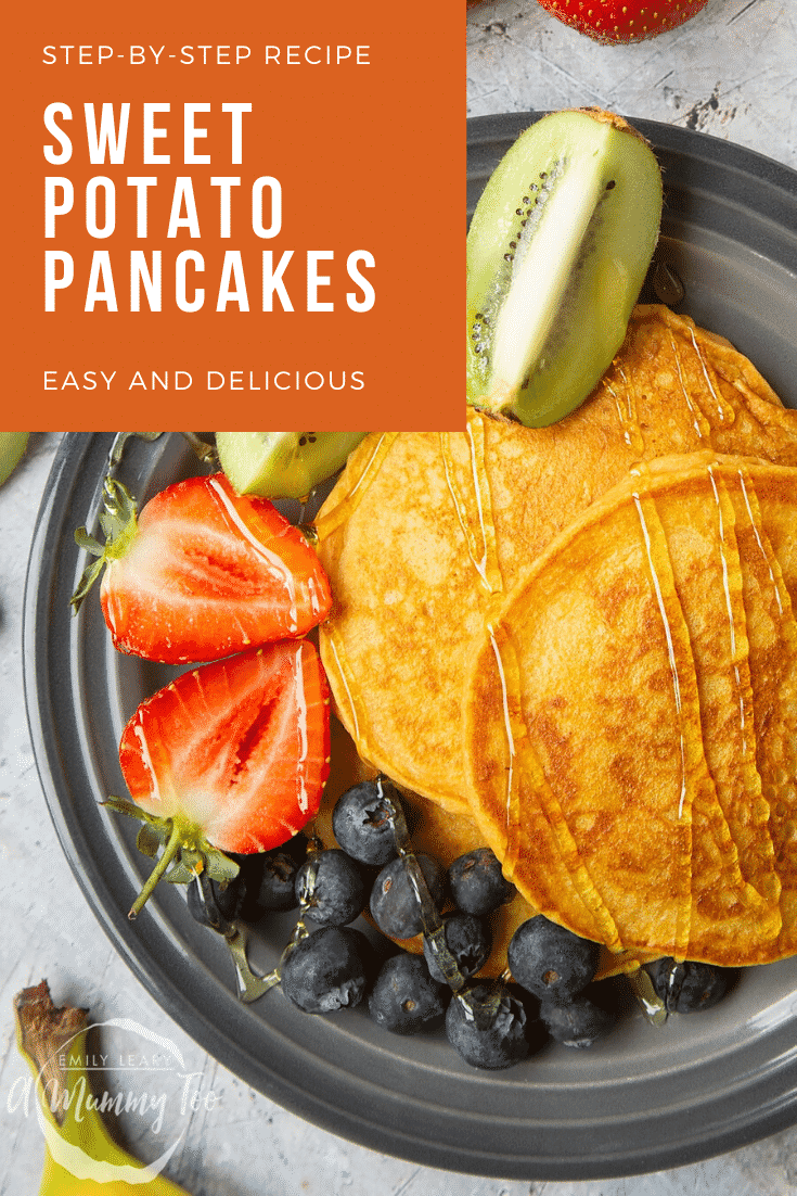 Overhead shot of sweet potoato pancakes on a black plate with a side of fruit. At the top right hand side of the image there's some text describing the image for Pinterest.
