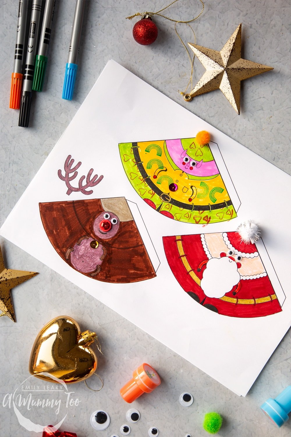 Crafty coloured in and decorated characters; elf, Santa and reindeer.