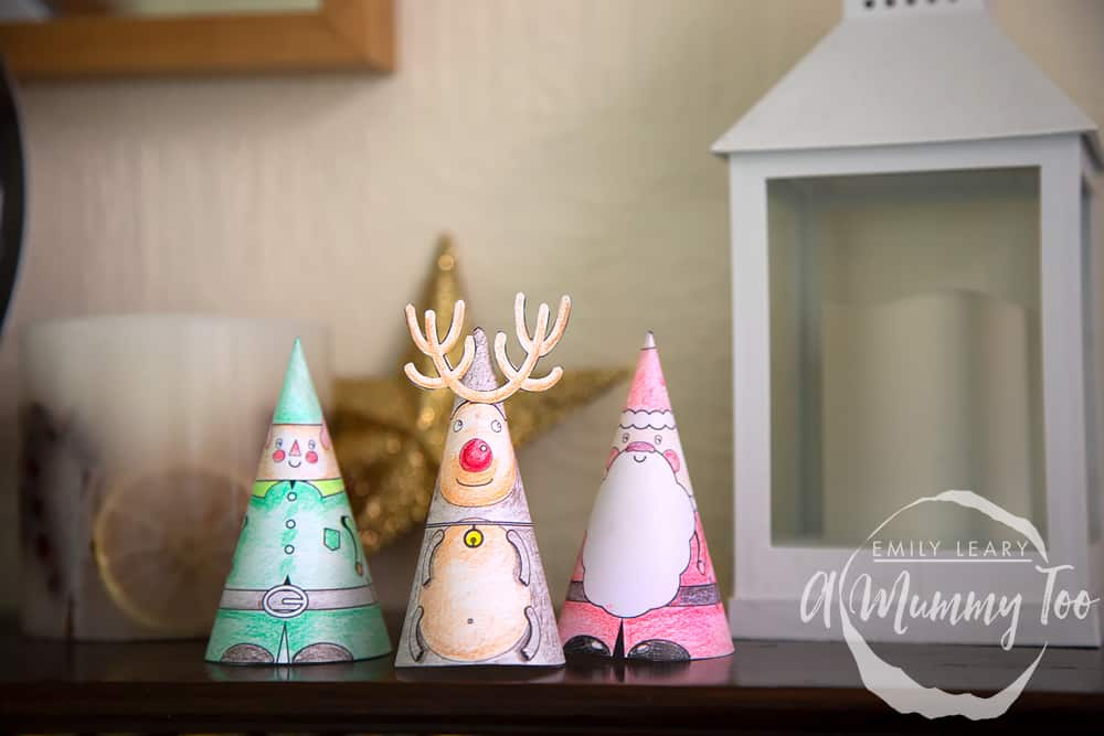 Decorated characters that can be used as mantlepiece decorations.