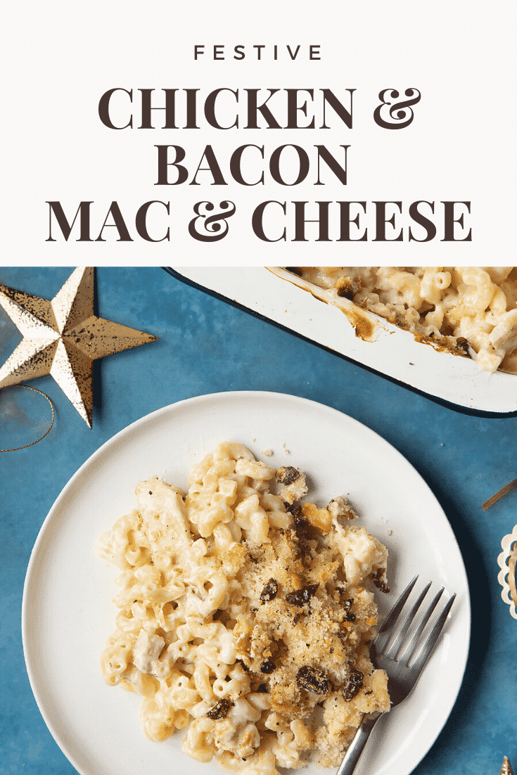 A portion of chicken and bacon mac and cheese served on a small white plate with a fork. A tray containing more of the pasta is shown to one side. Caption reads: festive chicken & bacon mac & cheese