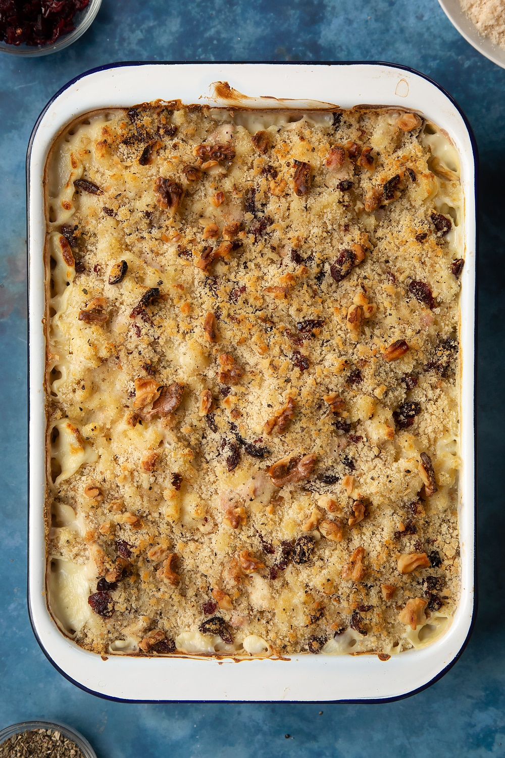 A large roasting pan filled with freshly baked chicken and bacon mac and cheese.