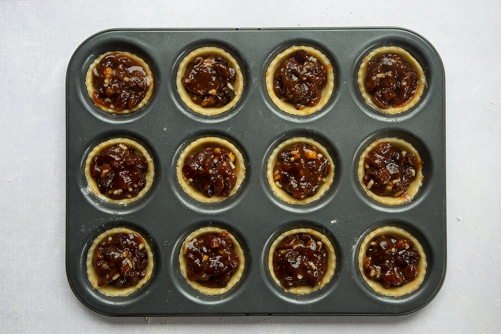 Tin lined with pastry discs and topped with mincemeat.