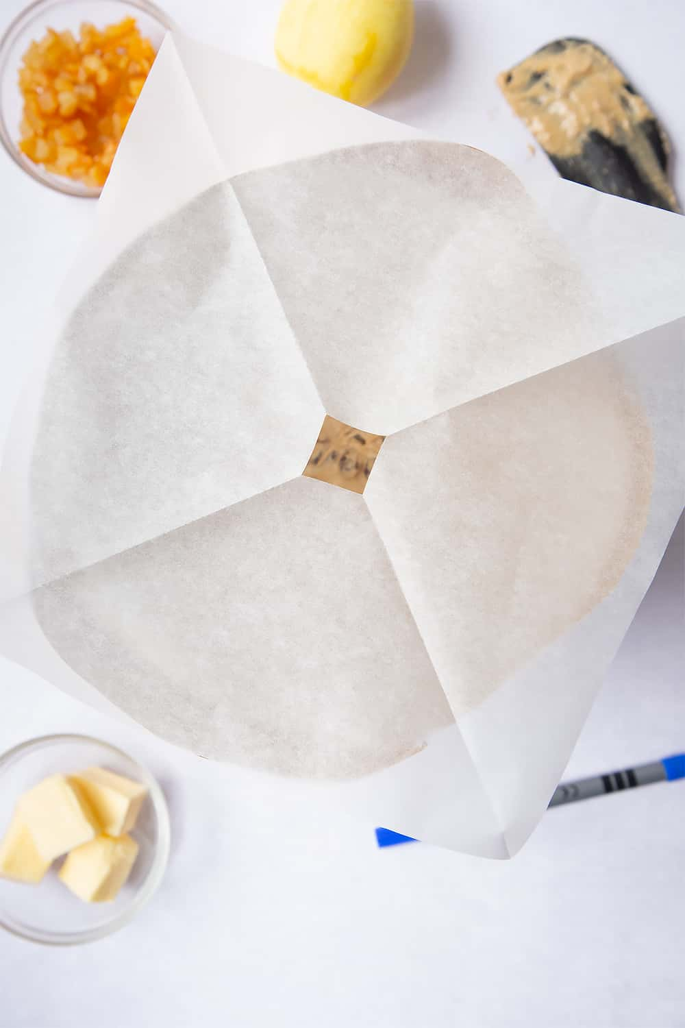 The end result of the cut of the square baking paper once unfolded from it's quartered shape.
