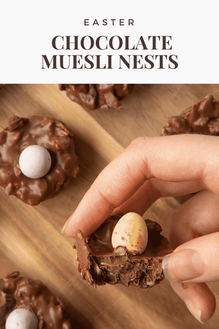 Front angle shot of a half-eaten fruity muesli nest with graphic text EASTER CHOCOLATE MUESLI NESTS above.