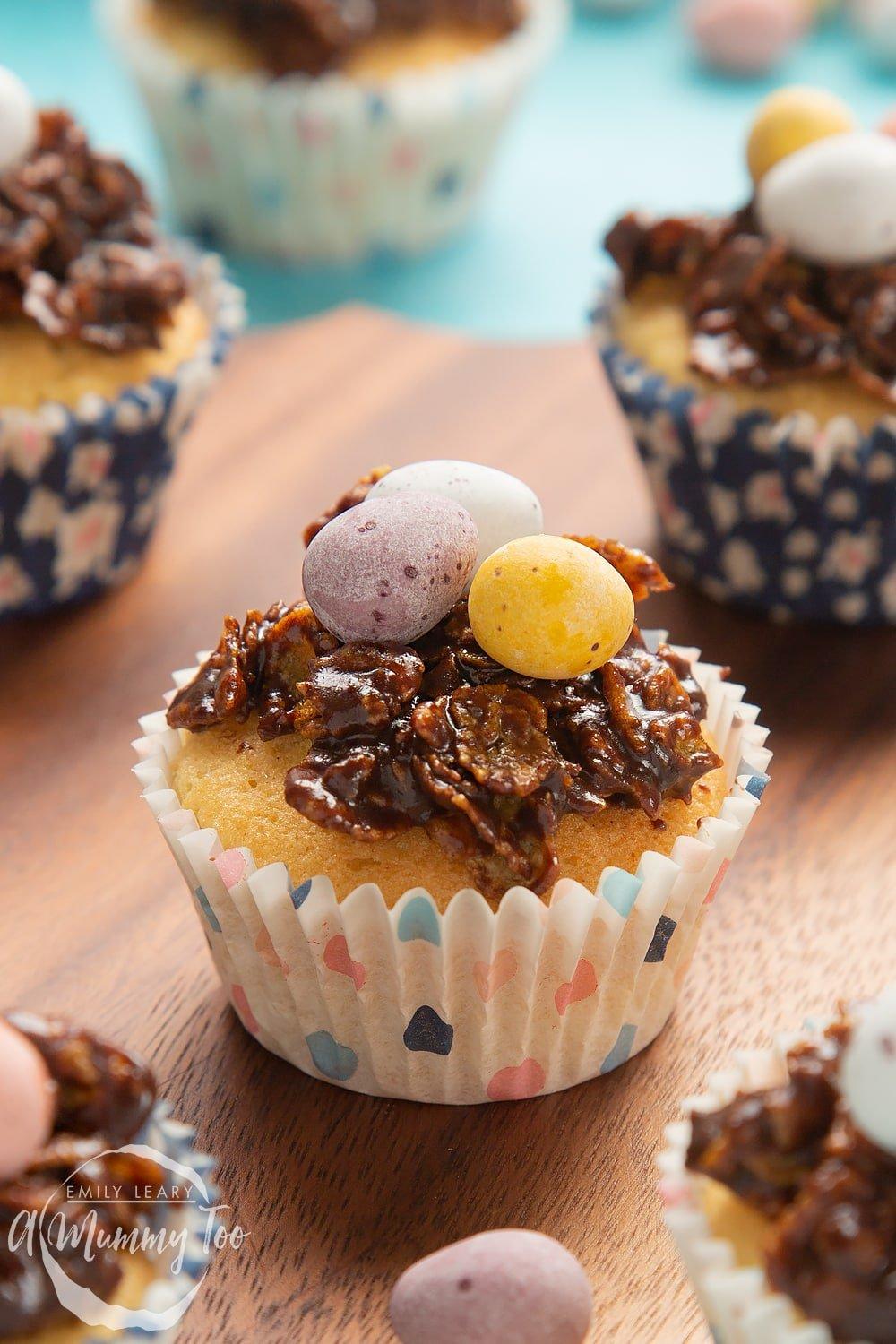 Front angle shot of Easter nest cupcakes served on a wooden plate