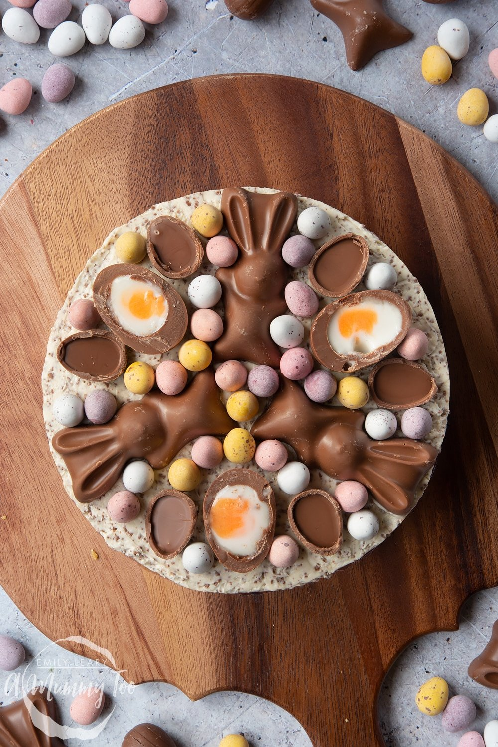 No-bake Easter cheesecake shown from above. The cheesecake is topped with mini chocolate eggs, creme eggs and chocolate bunnies.