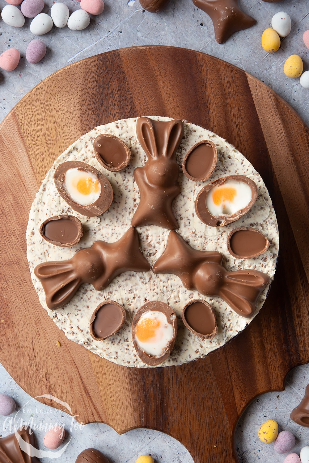 No-bake Easter cheesecake shown from above. The cheesecake is topped with creme eggs and chocolate bunnies.