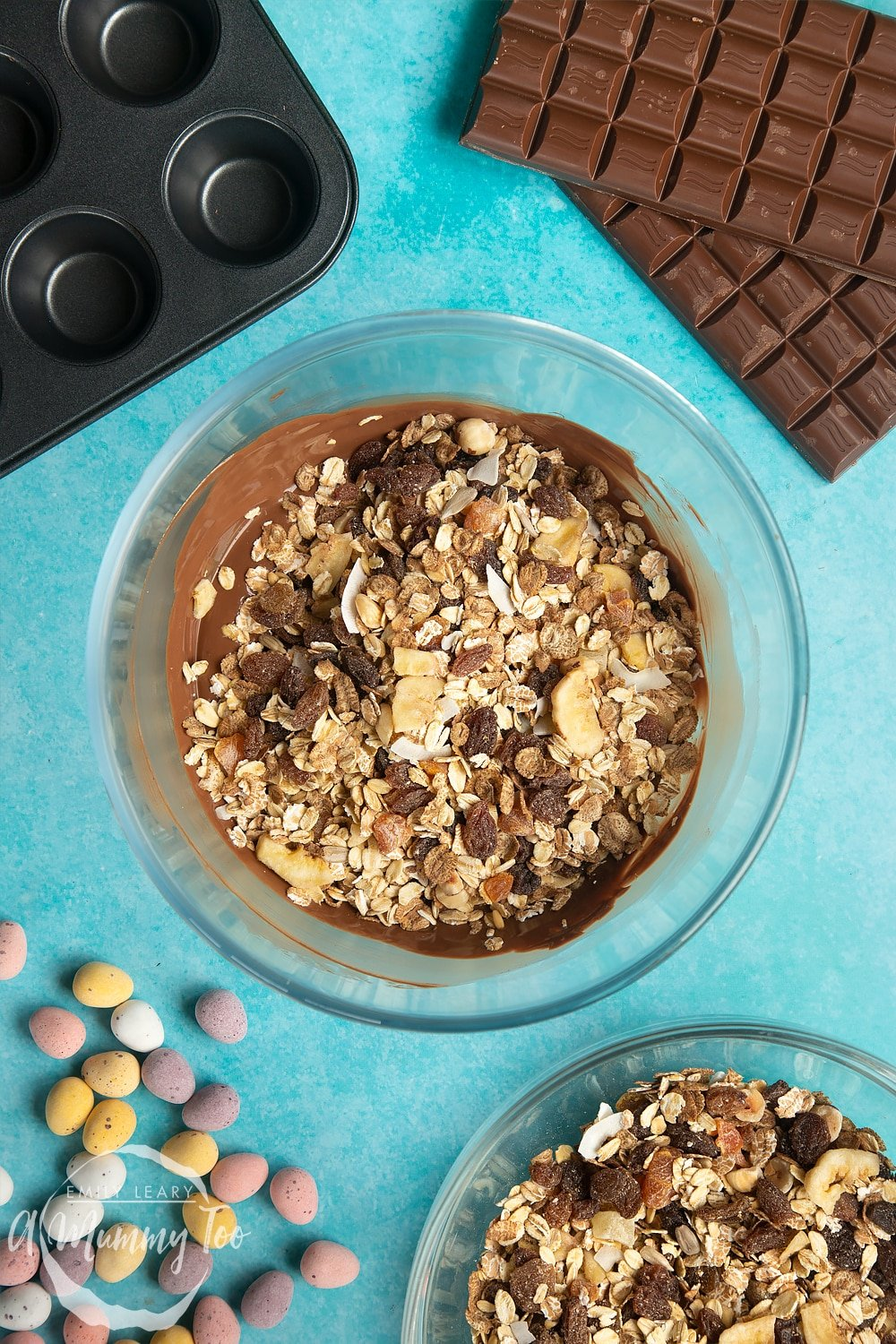 Overhead shot of melted chocolate on a muesli in a microwave-safe bowl