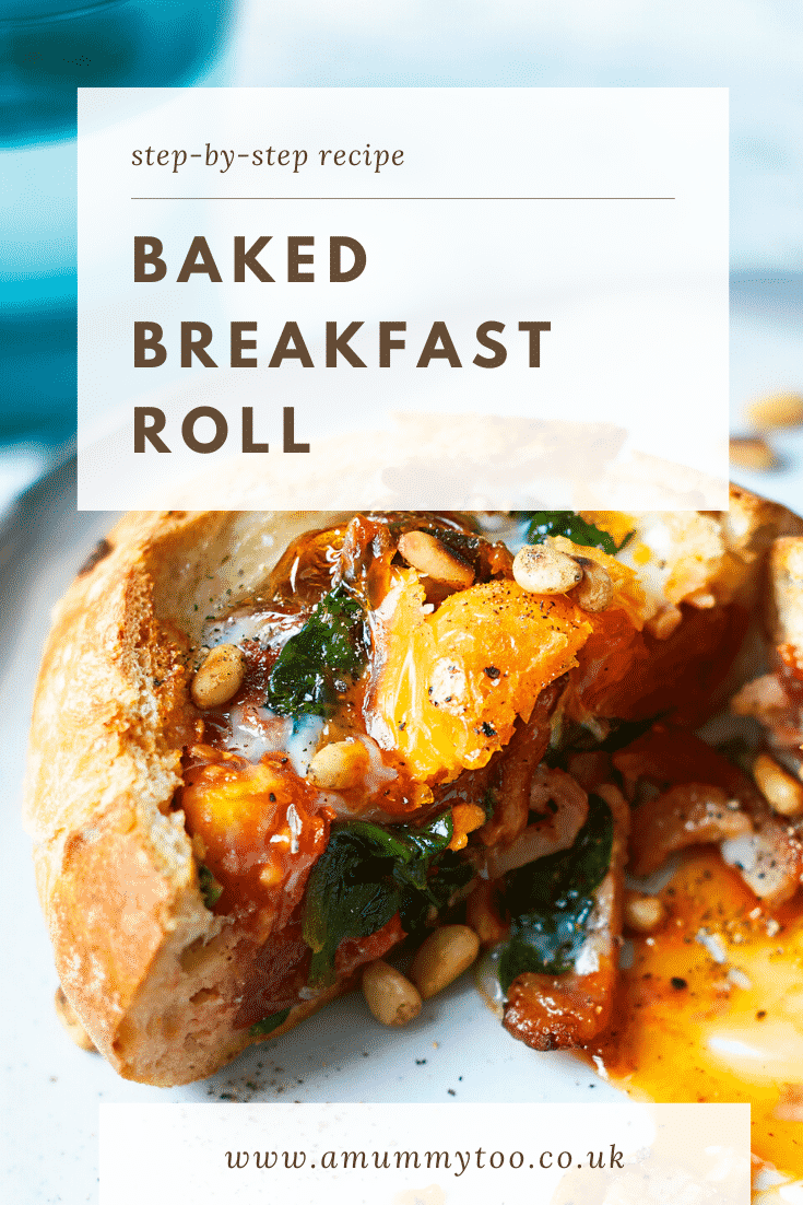 A breakfast roll on a white plate. It is filled with sausage, bacon, spinach, tomatoes and pine nuts, topped with an egg. The roll is cut open to reveal the runny egg yolk. The caption reads: step-by-step recipe baked breakfast roll