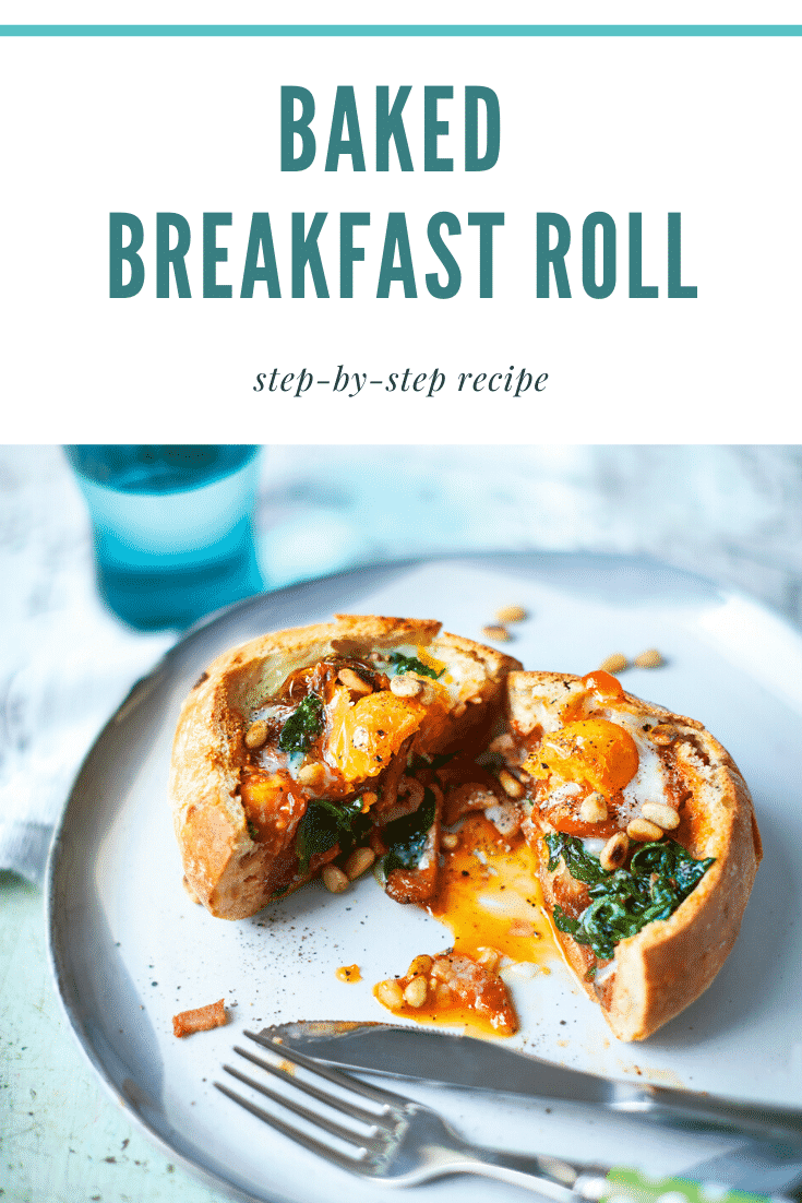 A breakfast roll on a white plate. It is filled with sausage, bacon, spinach, tomatoes and pine nuts, topped with an egg. The roll is cut open to reveal the runny egg yolk. The caption reads: baked breakfast roll step-by-step recipe