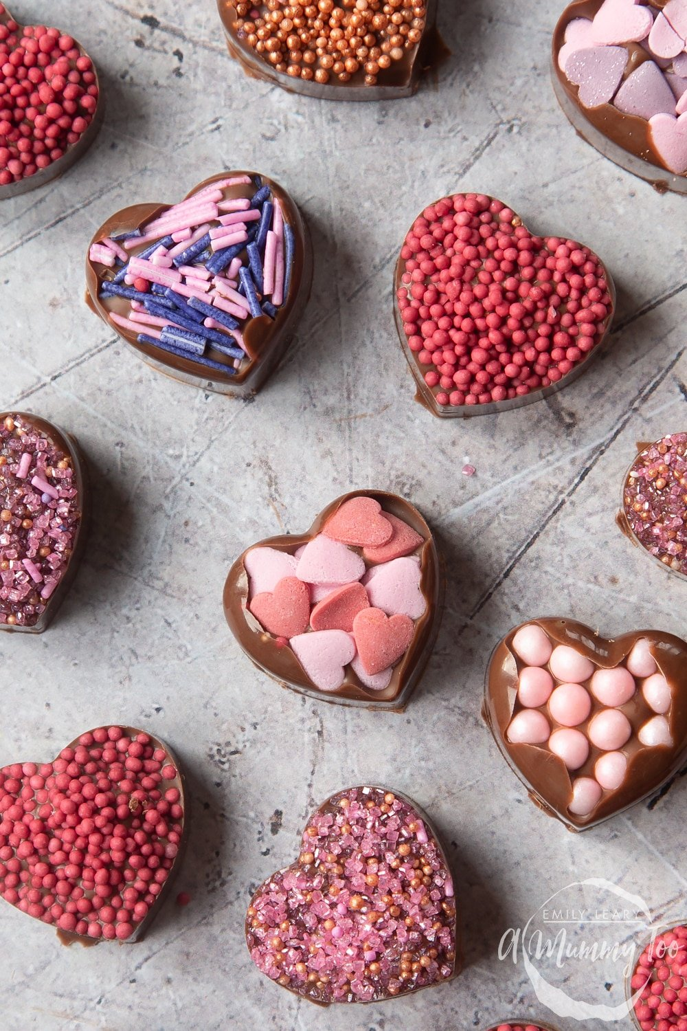 Overhead shot of chocolate hearts with a mummy too logo in the lower-right corner