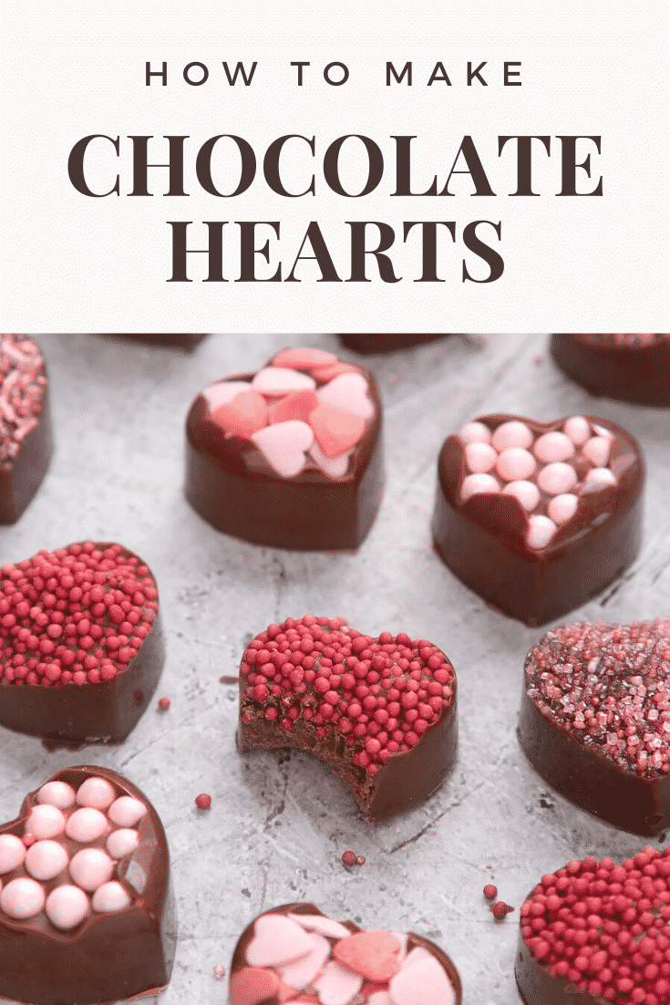 graphic text  HOW TO MAKE CHOCOLATE HEARTS above Front angle shot of DIY chocolate hearts valentines with sprinkles on top