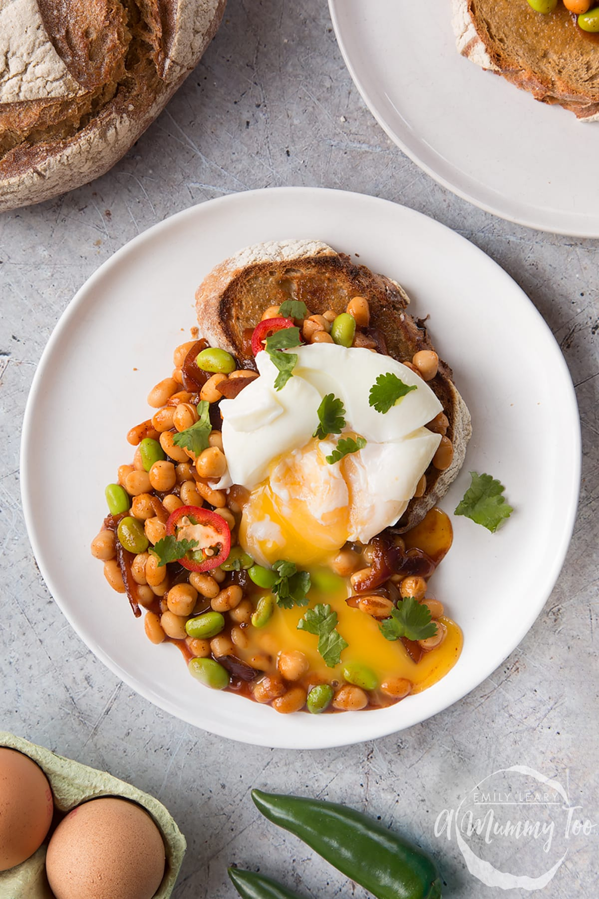 Breakfast beans with chilli, chickpeas and edamame served on sour dough toast with a poached egg on top.