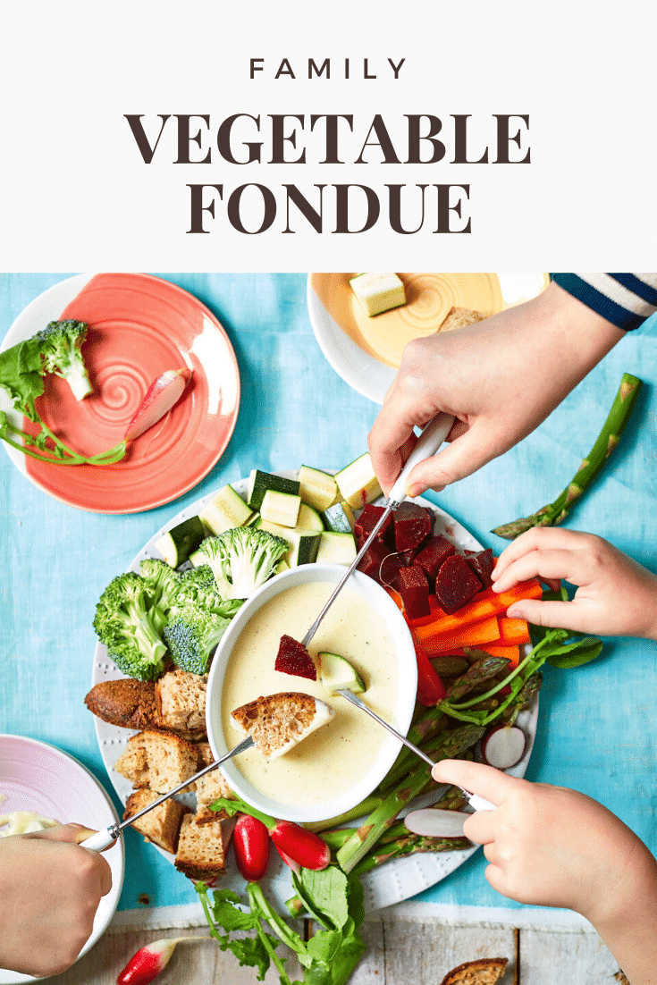A vegetable fondue platter on a blue background. A family of hands reach in with fondue forks to dip bread, beetroot, courgette into cheese sauce. The caption reads: family vegetable fondue