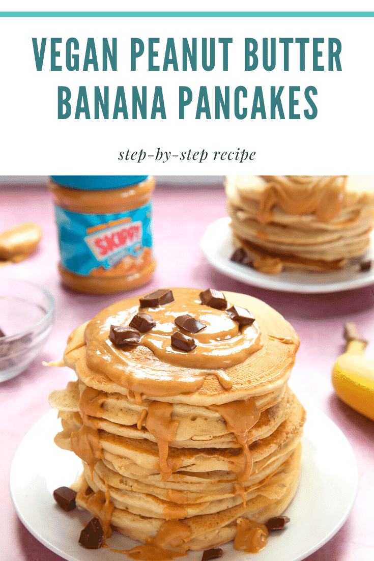 A stack of vegan peanut butter banana pancakes on a white plate. The stack is drizzled with more peanut butter and scattered with chunks of vegan chocolate. The caption reads: vegan peanut butter banana pancakes step-by-step recipe.