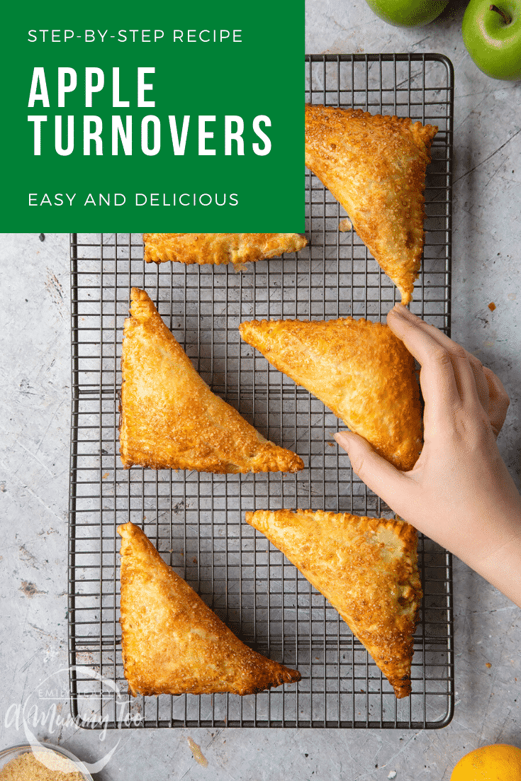 graphic text STEP-BY-STEP RECIPE APPLE TURNOVERS EASY AND DELICIOUS above Overhead shot of a hand holding an apple cinnamon turnover with a mummy too logo in the lower-left corner.