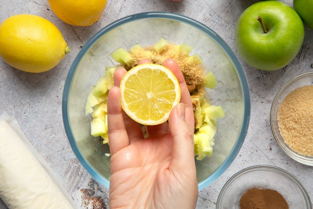 Overhead shot of a hand holding a lemon