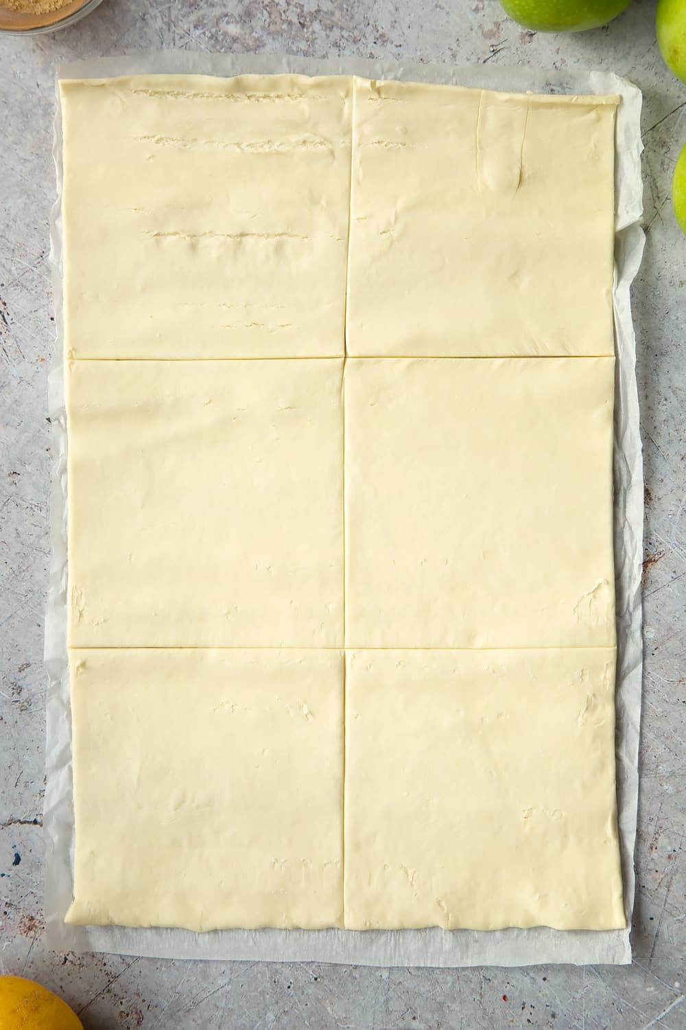 Overhead shot of one sheet of puff pastry with six divisions