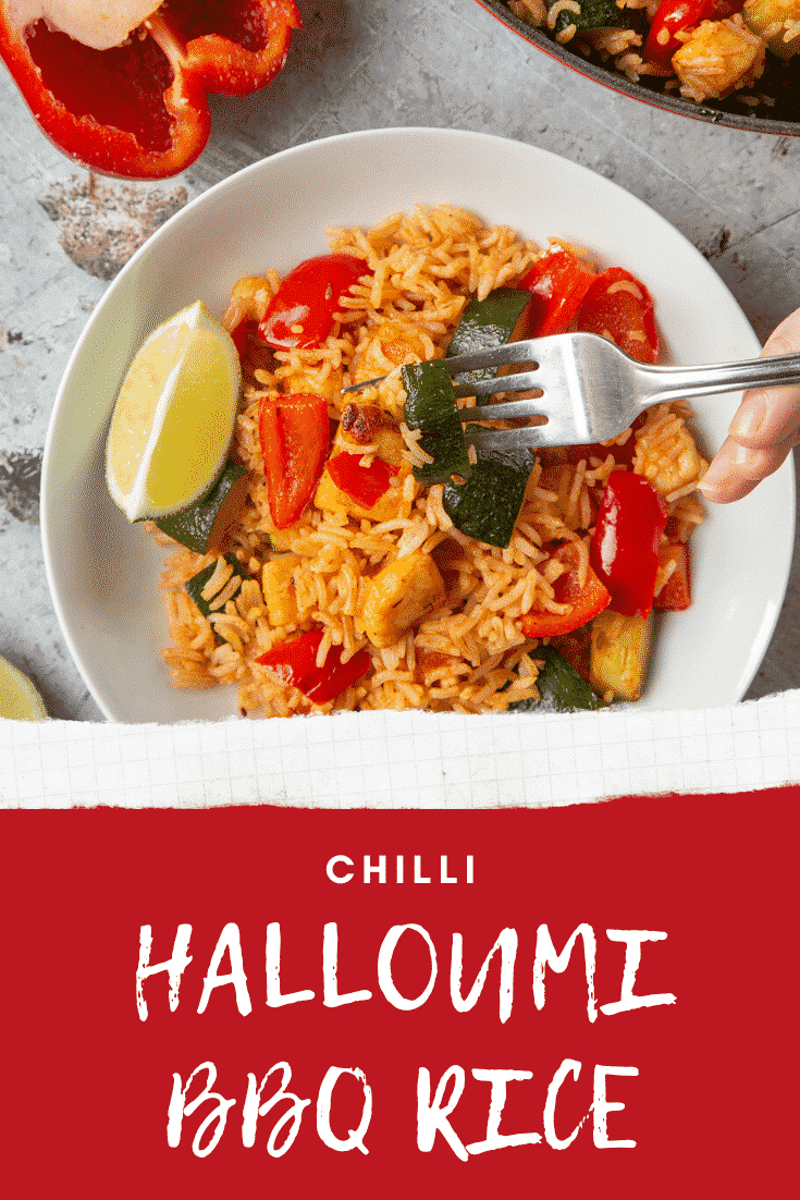 overhead shot of hand holding a fork picking up spicy bbq halloumi rice with graphic text CHILLI HALLOUMI BBQ RICE below