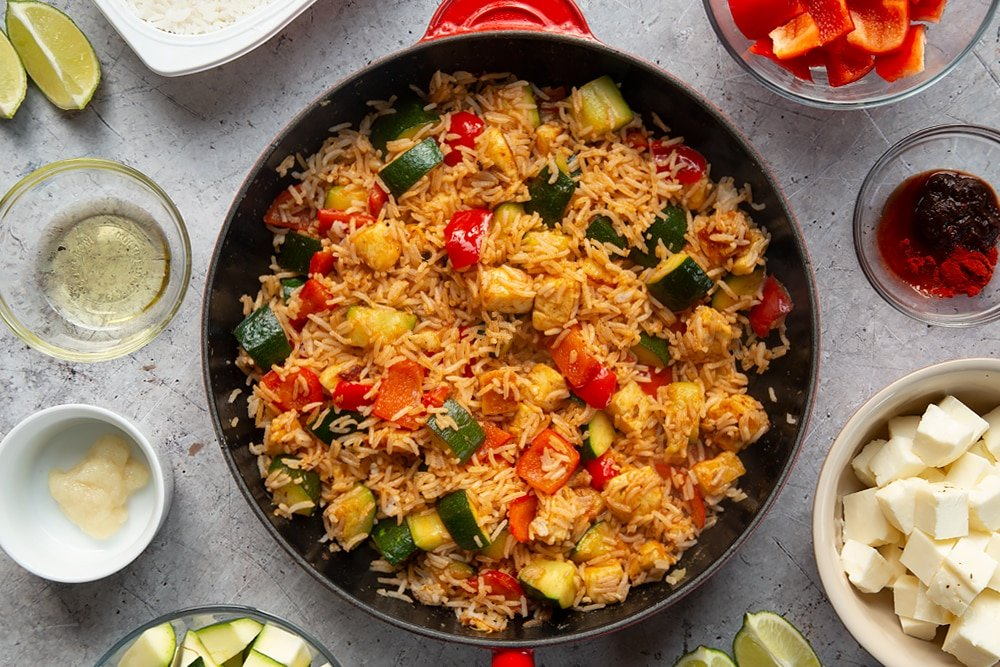 Overhead shot of Chilli BBQ halloumi rice in a large red pan