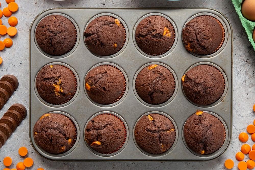 Overhead shot of chocolate orange muffins in muffin tray