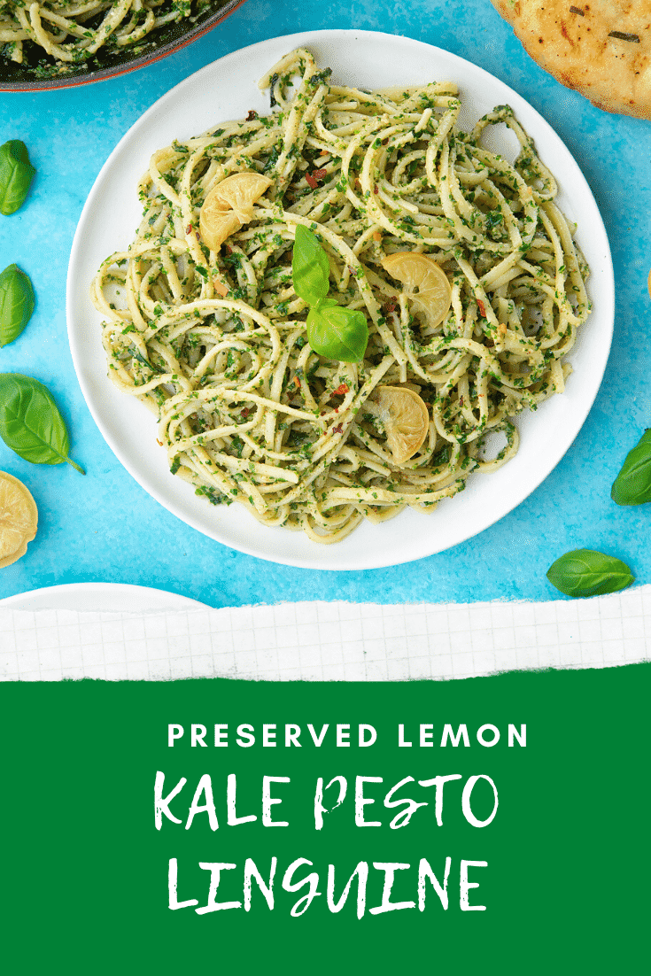 A white plate with kale pesto linguine, topped with basil and slices of preserved lemons. A caption reads: preserved lemon kale pesto linguine.