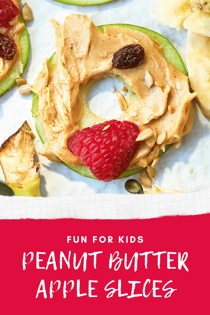 A close up of an apple slice topped with peanut butter. The caption reads: Fun for kids - peanut butter apple slices.