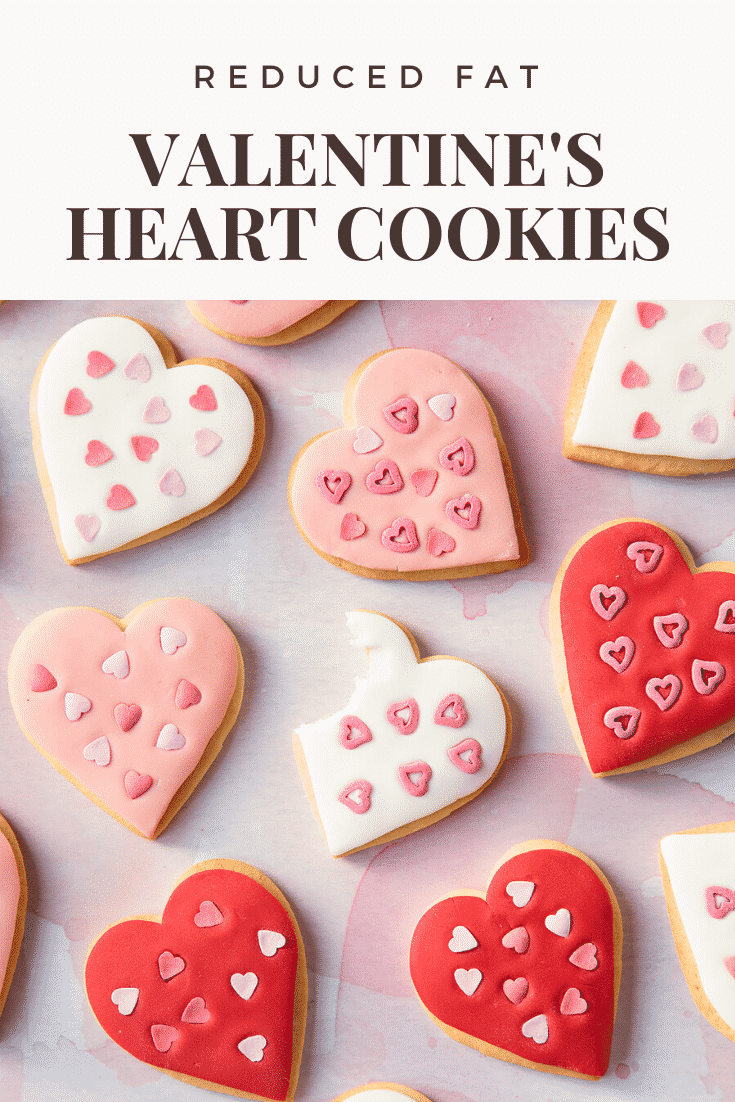 graphic text REDUCED FAT VALENTINE'S DAY COOKIES above Overhead shot of valentines day cookies