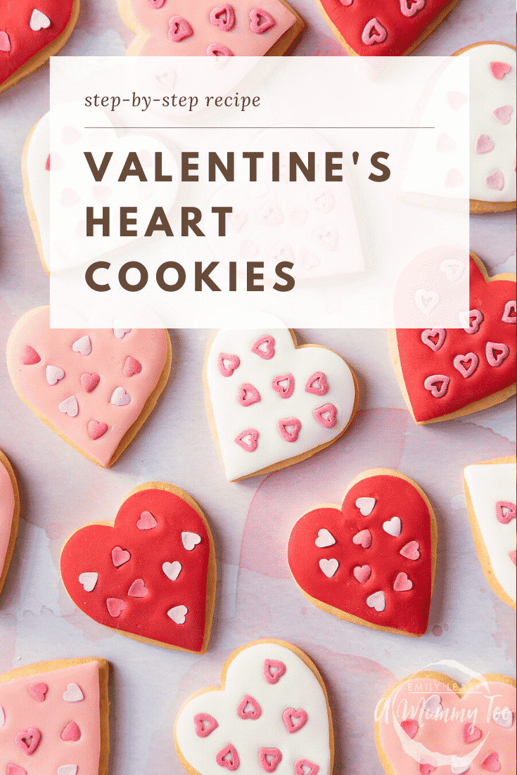 graphic text VALENTINE'S HEART BISCUITS step-by-step recipe above Overhead shot of a hand holding a heart-shaped cookies