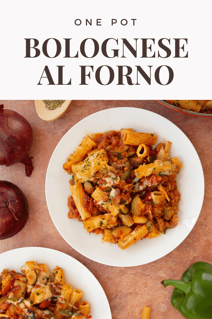 Freshly baked bolognese al forno served to two plates. Caption reads: One pot bolognese al forno
