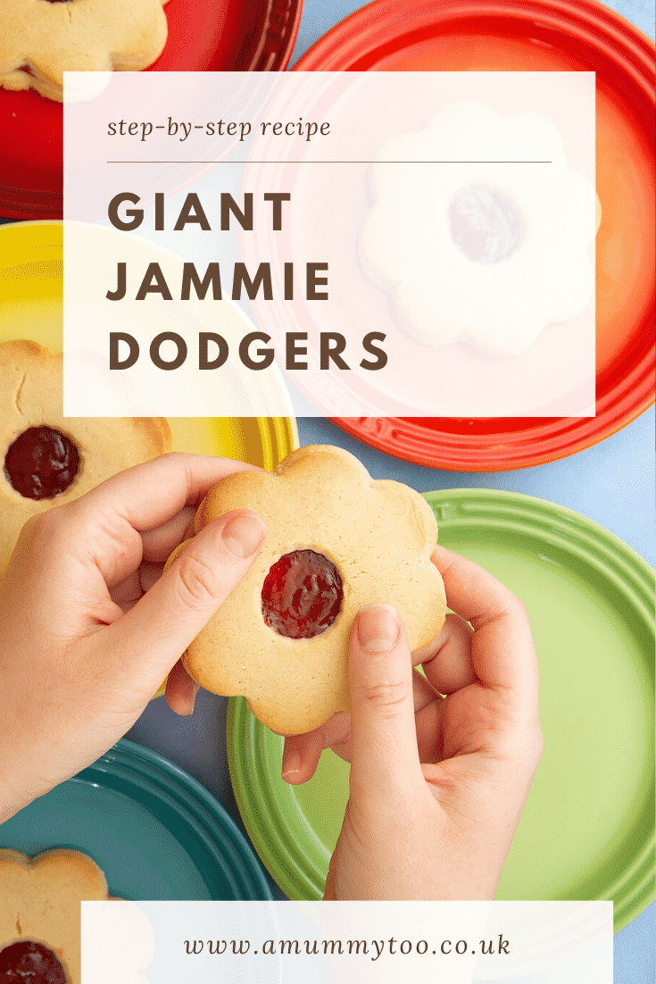 Giant jammie dodgers arranged on a variety of rainbow coloured small plates. Two hands hold one. Caption reads: step-by-step recipe giant jammie dodgers