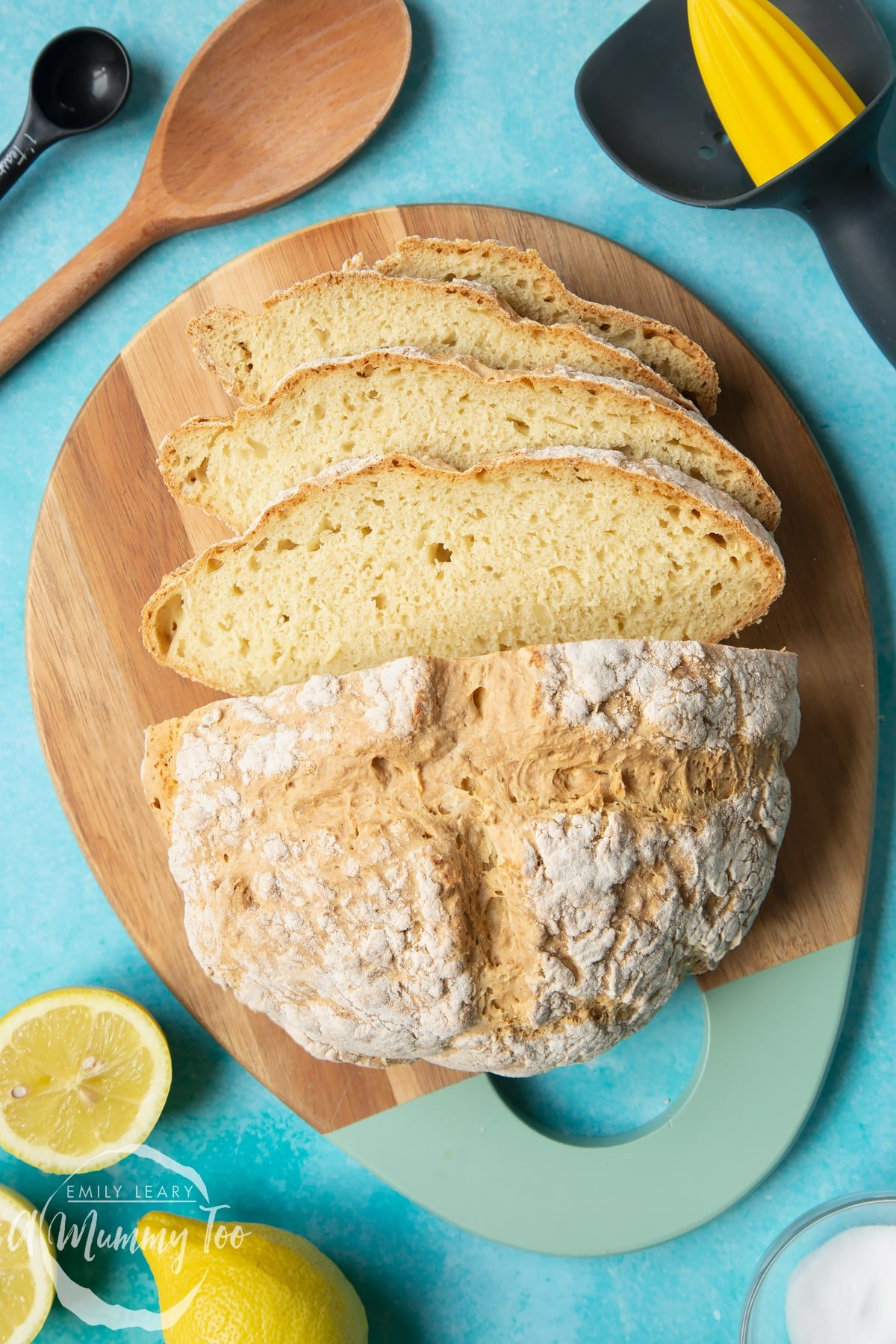 Vegan soda bread on a wooden board. Some of the bread has been cut into slices.
