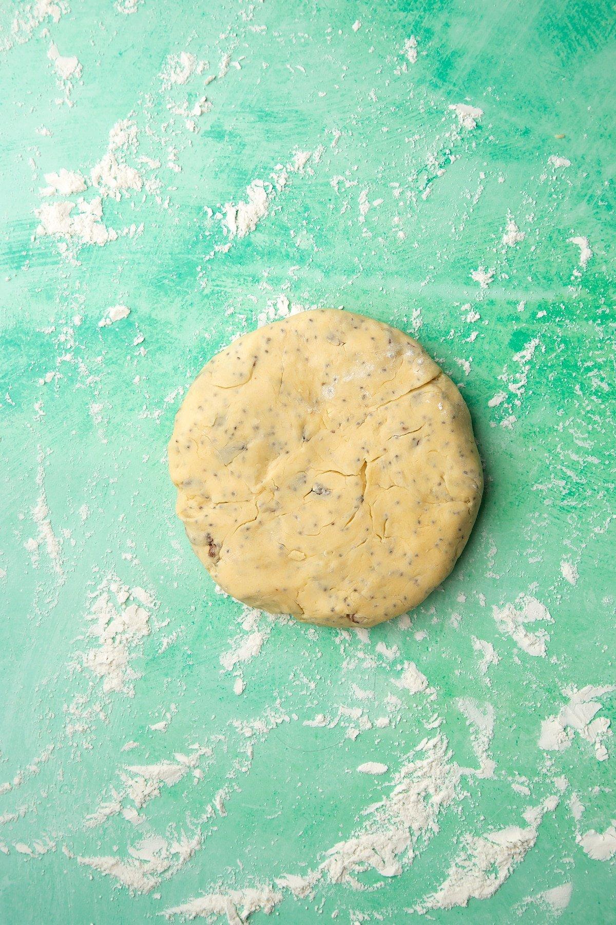 Vegan Welsh cakes dough on a floured surface.
