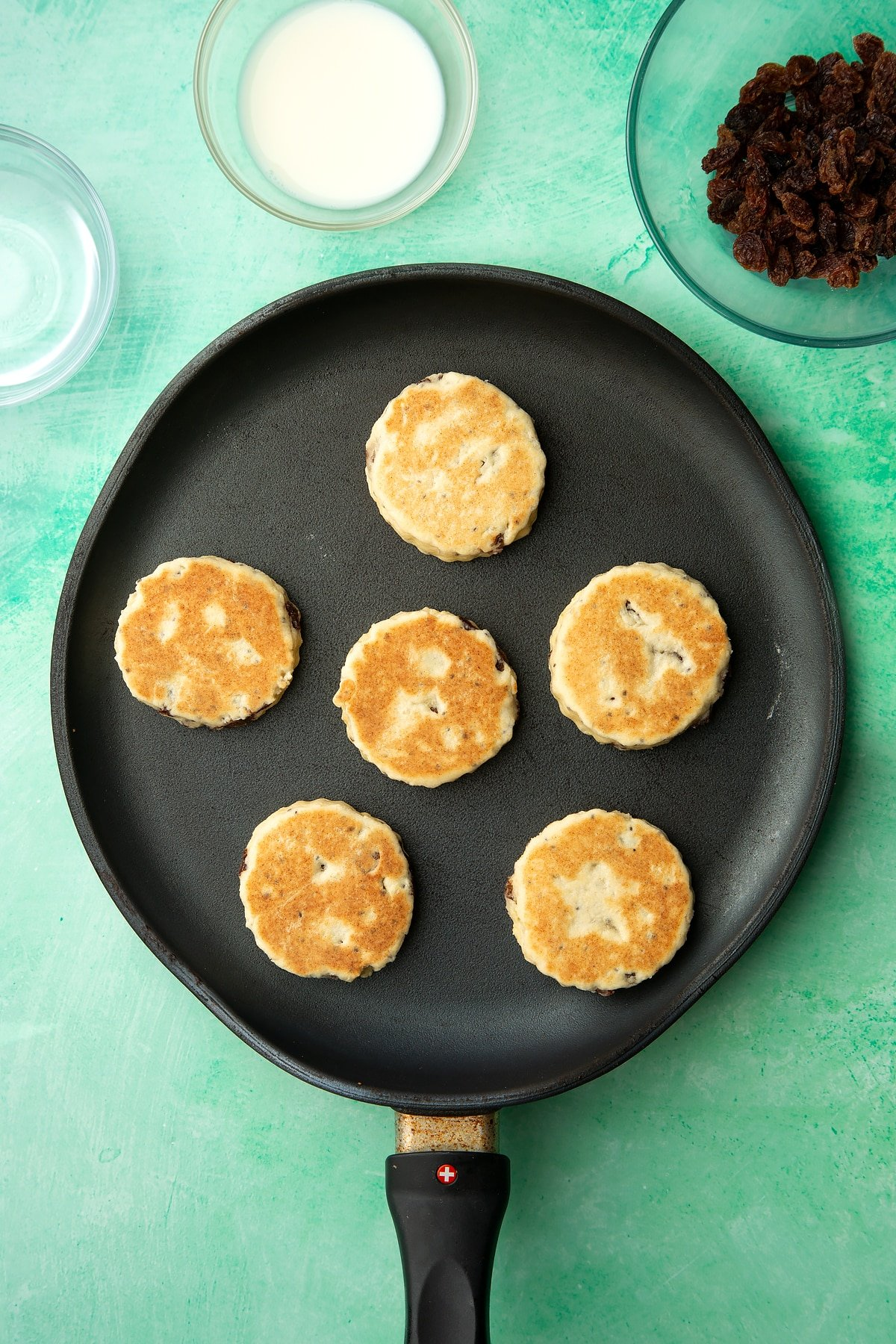 Cooked Vegan Welsh cakes in a pan.