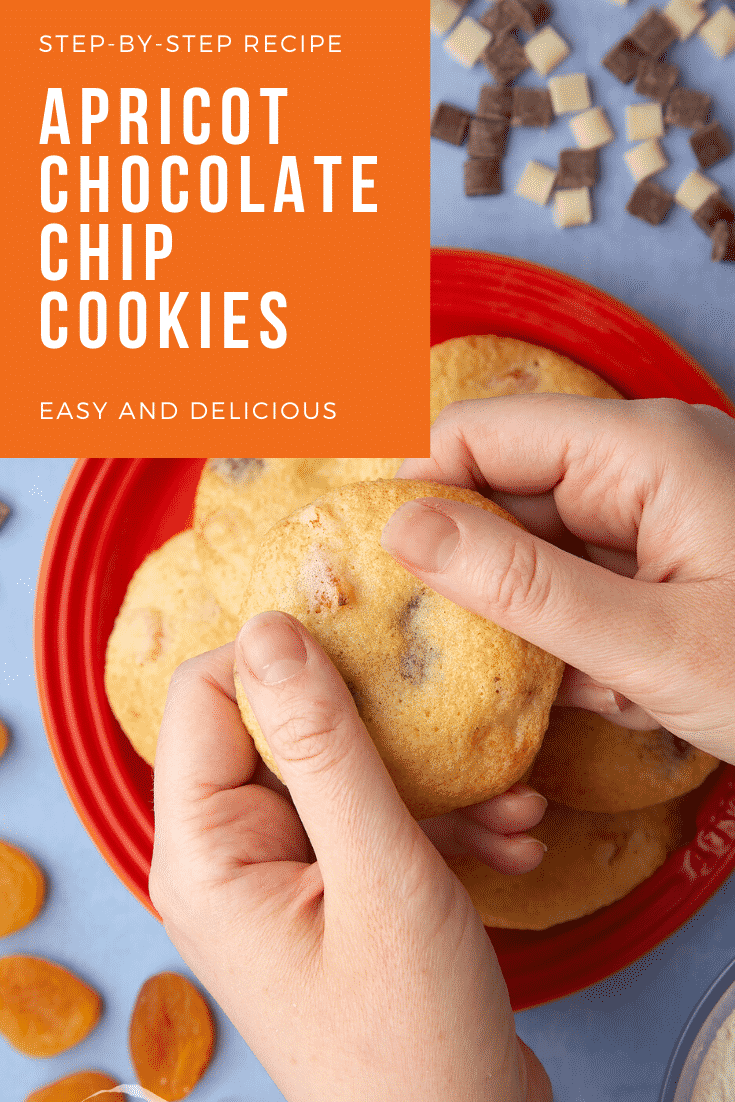 Apricot chocolate chip cookies stacked on a small orange plate. Chocolate chips and dried apricots are scattered around. Hands hold a cookie. Caption reads: step-by-step recipe apricot chocolate chips cookies easy and delicious