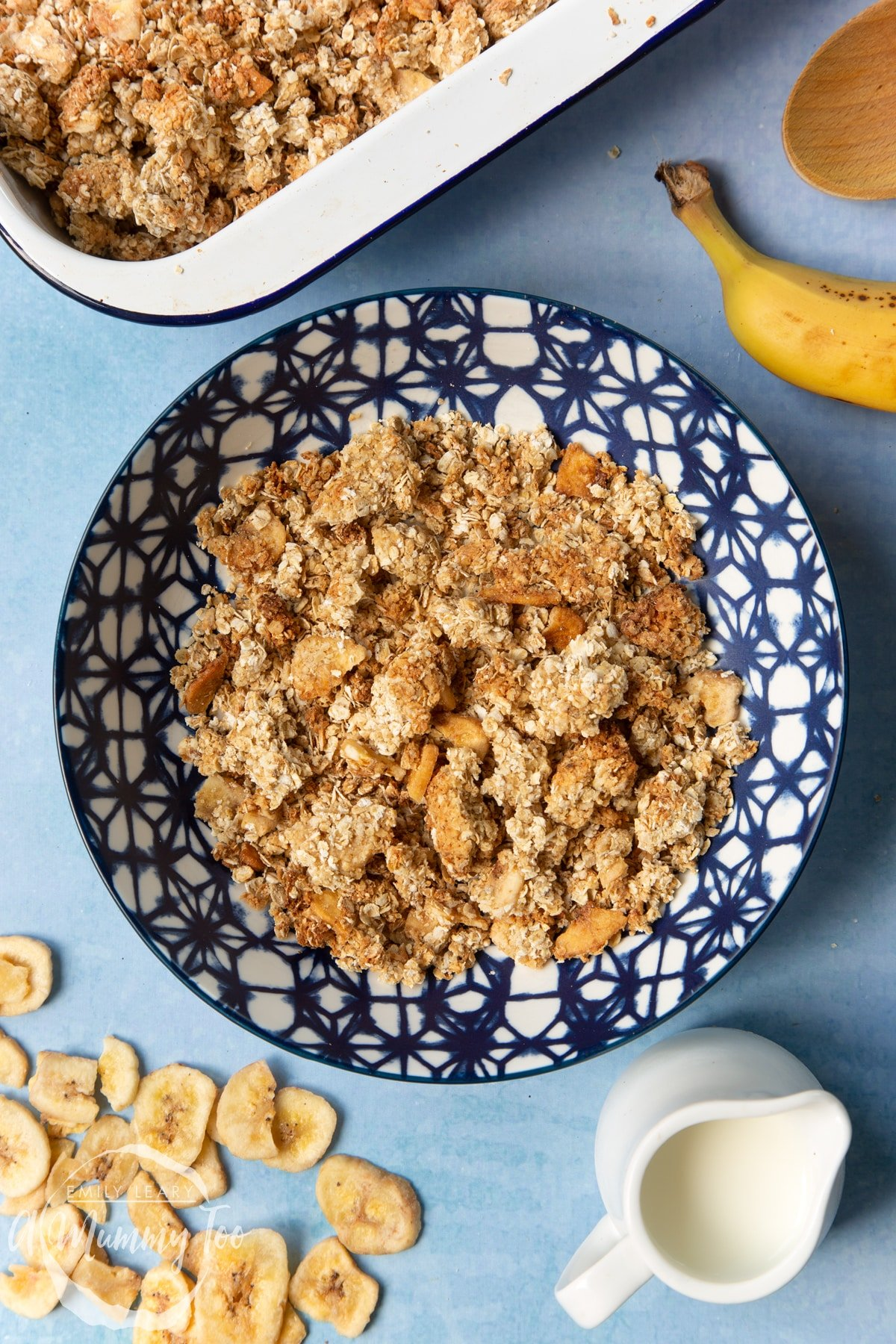 Banana coconut granola served in a blue and white bowl.