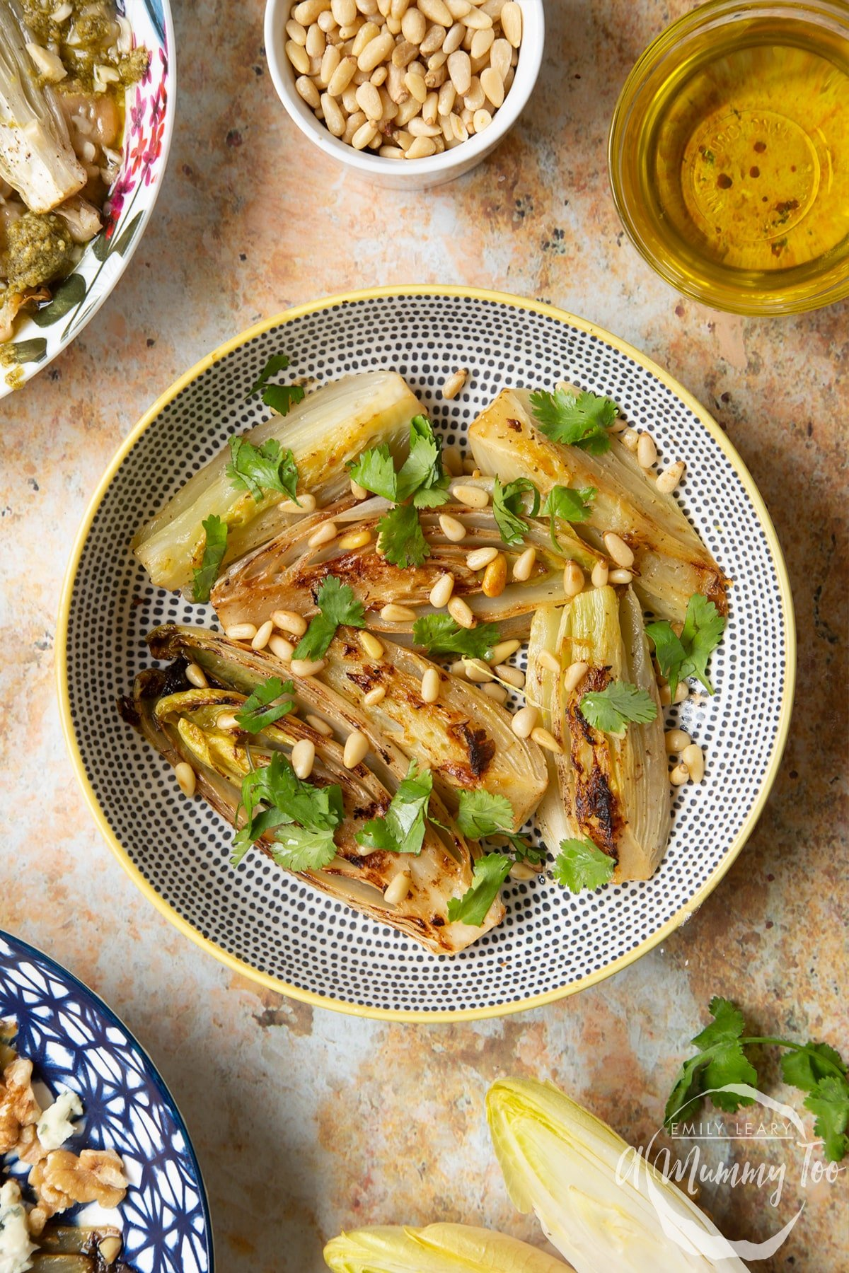 Braised chicory in a bowl with fennel, pine nuts and coriander.