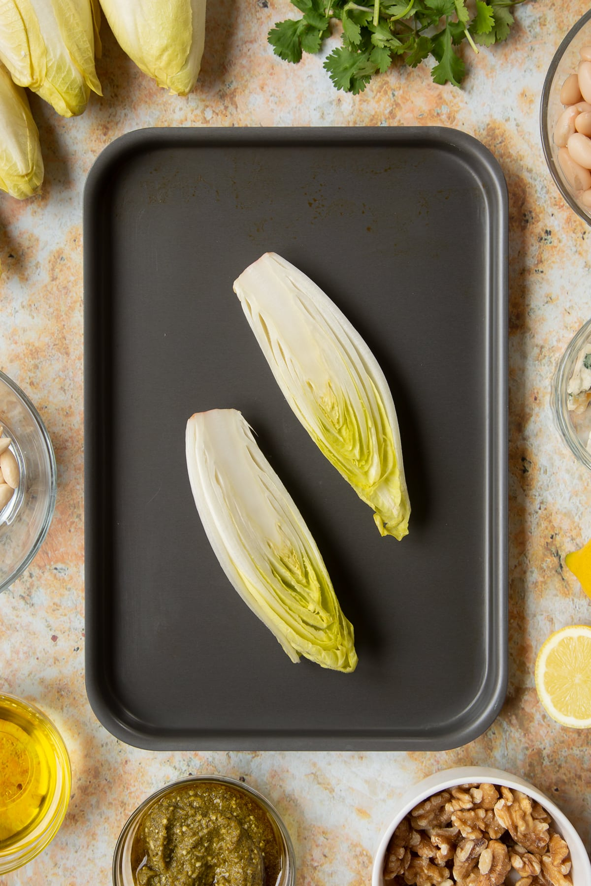 Chicory halves on a tray.