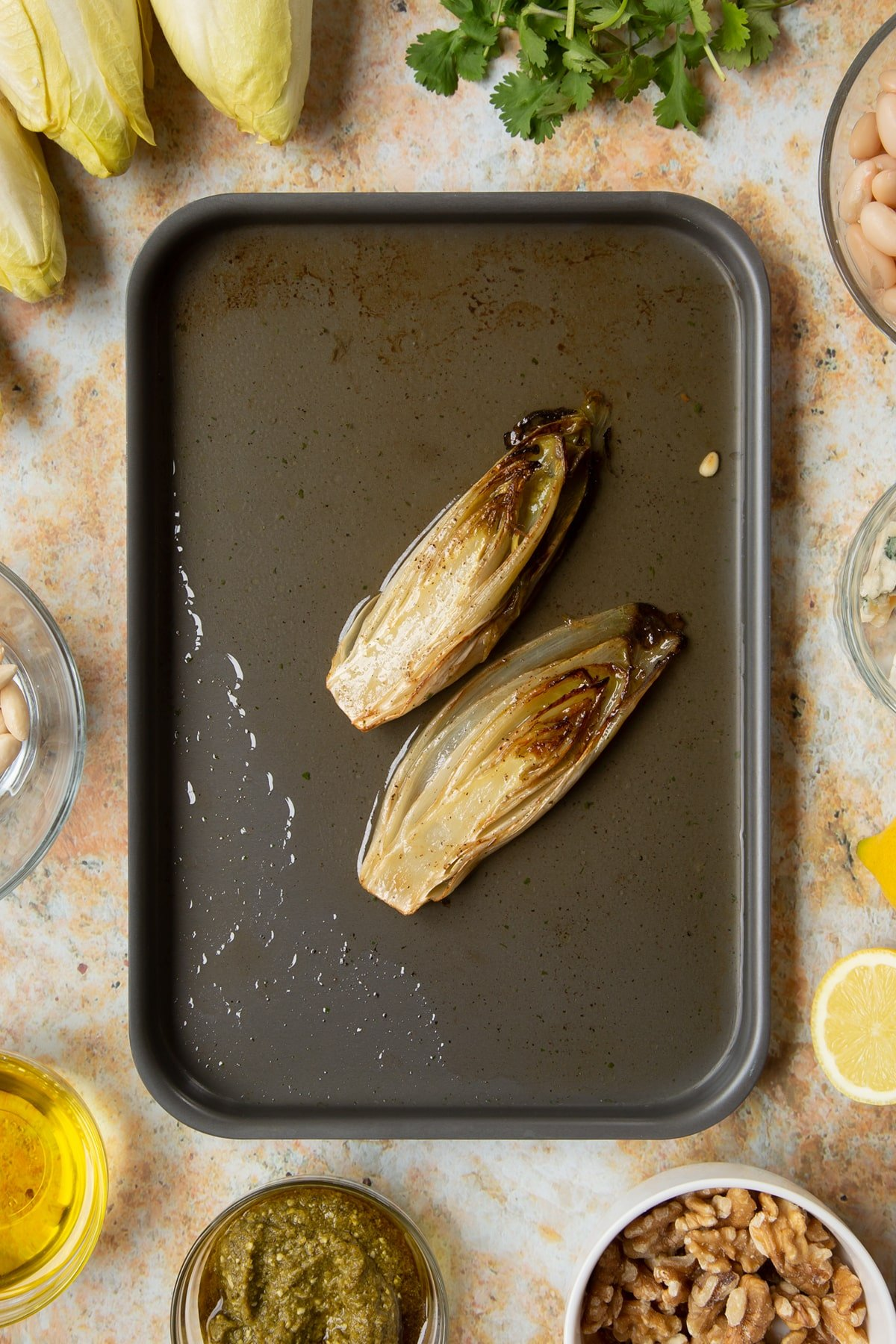 Grill braised chicory in a tray.