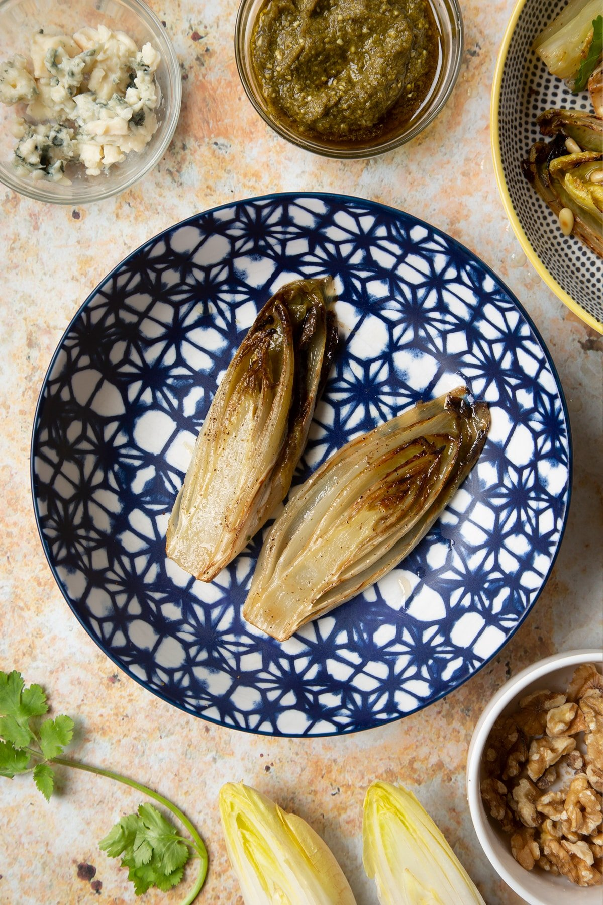 Grill braised chicory in a bowl.